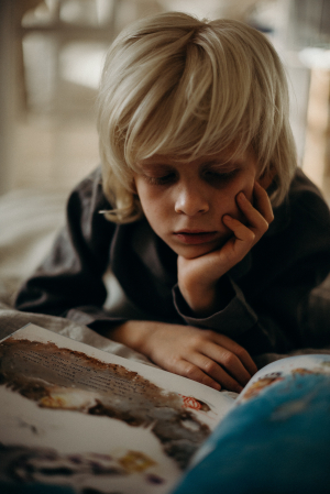 selective-focus-photography-of-boy-resting-his-head-on-his-3171067.jpg